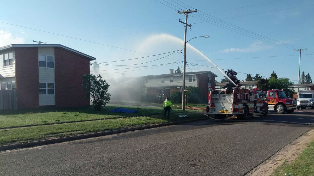 Firefighters spray water on a duplex at 504 Invader St. in K.I. Sawyer, June 1, 2020 (WLUC image).