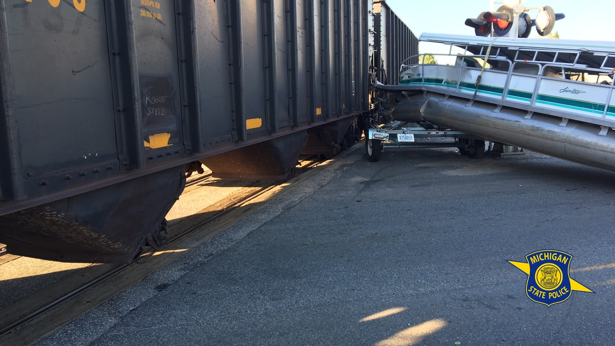 A train and pickup truck towing a boat collided Friday evening in Chippewa County.