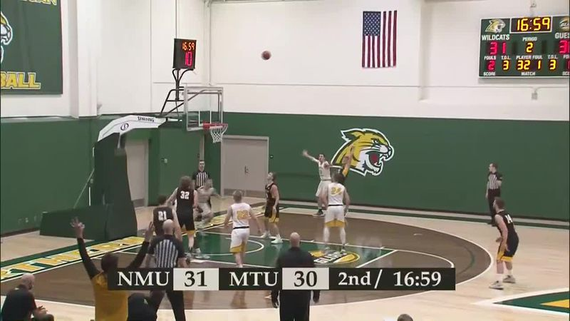 Tech's Owen White hits a three-pointer to give the Huskies a 33-31 lead over Northern Michigan.