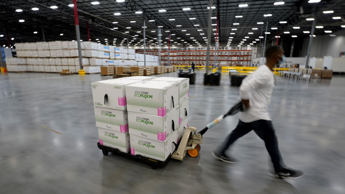 FILE PHOTO. Boxes containing the Moderna COVID-19 vaccine are moved to the loading dock for...